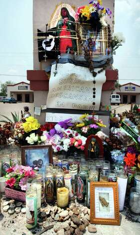 A shrine still stands at the site where 9 immigrants died in a van crash in Palmview, Texas,  Wednesday April 11, 2012.  The accident occurred a few blocks from where U.S. Border Patrol units attempted to stop the vehicle. Six other passengers in the van were injured.  Thursday, May 3, 2012. Photo: Bob Owen, San Antonio Express-News / © 2012 San Antonio Express-News