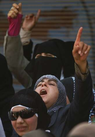 Syrian women chant slogans during an anti-Bashar Assad protest after Friday prayers on the outskirts of Idlib, Syria, Friday, June 8, 2012.  (AP Photo) Photo: Anonymous, Associated Press