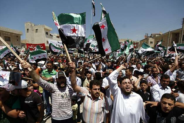 Syrians attend an anti-Bashar Assad protest after Friday prayers on the outskirts of Idlib, Syria, Friday, June 8, 2012. (AP Photo) Photo: Anonymous, Associated Press