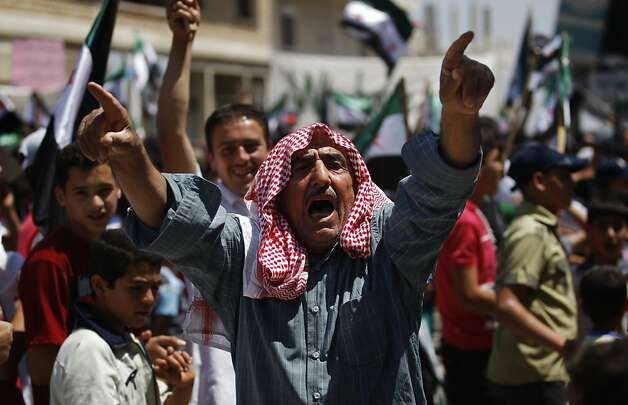 A Syrian man chants slogans during an anti-Bashar Assad protest after Friday prayers on the outskirts of Idlib, Syria, Friday, June 8, 2012.  (AP Photo) Photo: Anonymous, Associated Press