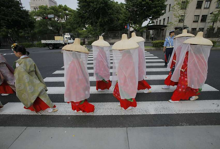 Hie Shrine maidens march through a Tokyo street during the biennial Sanno Festival parade Friday, June 8, 2012. (AP Photo/Itsuo Inouye)