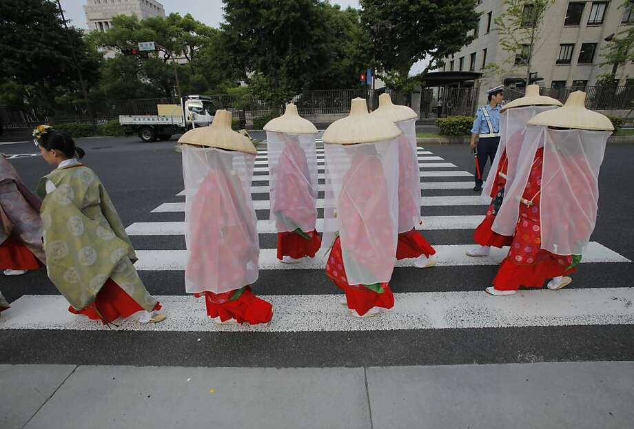 Hie Shrine maidens march through a Tokyo street during the biennial Sanno Festival parade Friday, June 8, 2012. (AP Photo/Itsuo Inouye) Photo: Itsuo Inouye, Associated Press