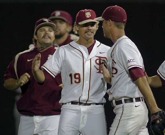 Florida State pitchers Scott Sitz and Gage Smith (19) congratulate relief pitcher Mack Waugh, right, after an NCAA college baseball tournament super regional game against Stanford, Friday, June 8, 2012, in Tallahassee, Fla. Florida State won 17-1. (AP Photo/Phil Sears) Photo: Phil Sears, Associated Press