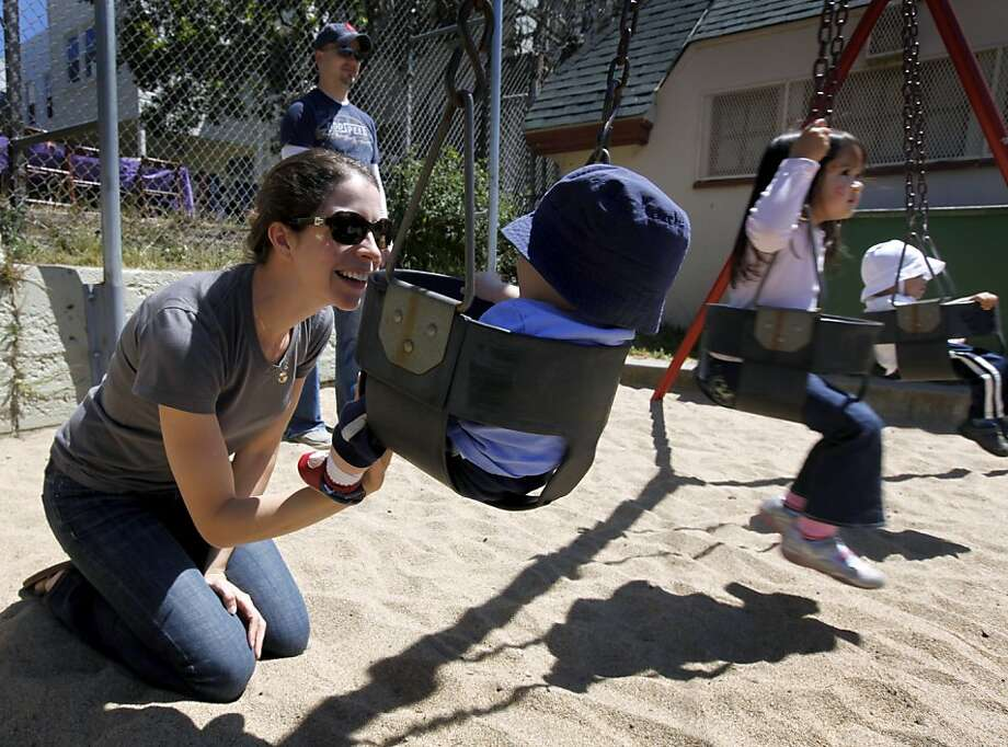 Jessamine Fitzpatrick swings her son Lochlan, 7 months, in the tot lot at Cabrillo Playground in San Francisco, Calif. on Saturday, June 9, 2012. The Recreation and Parks department is rebuilding the playground and will reopen in 2013. Photo: Paul Chinn, The Chronicle
