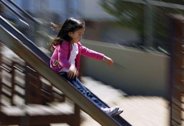 A young girl zooms down the slide at Cabrillo Playground in San Francisco, Calif. on Saturday, June 9, 2012. The Recreation and Parks department is rebuilding the playground and will reopen in 2013. Photo: Paul Chinn, The Chronicle