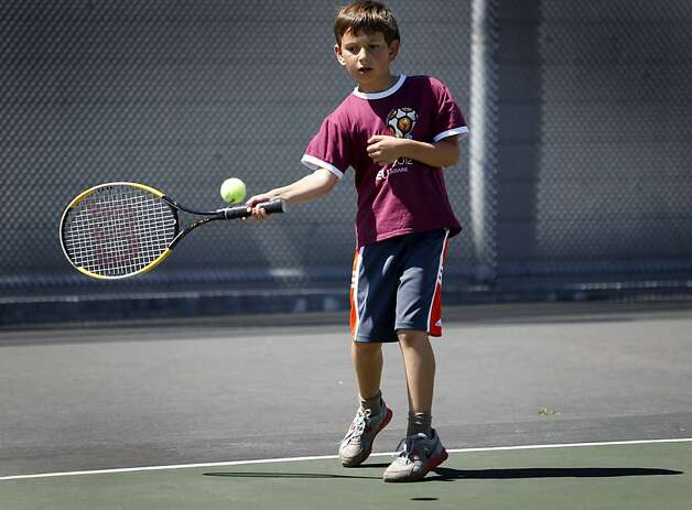 Victor Marmer, 10, takes a tennis lesson at Cabrillo Playground in San Francisco, Calif. on Saturday, June 9, 2012. The Recreation and Parks department is rebuilding the playground and will reopen in 2013. Photo: Paul Chinn, The Chronicle