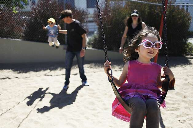 The city breaks ground on Cabrillo Playground in San Francisco, Calif. on Saturday, June 9, 2012. Lily, 4, is enjoying the swing. Even the family is living in the neighborhood It's not their favorite playground but they will give it another chance as soon as it is fixed. Photo: Sonja Och, The Chronicle