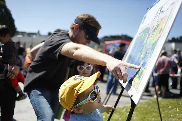 The city breaks ground on Cabrillo Playground in San Francisco, Calif. on Saturday, June 9, 2012. Patrick Hannan is showing his children Cole, 2, and Lily, 4, how the new playground will look like. Photo: Sonja Och, The Chronicle