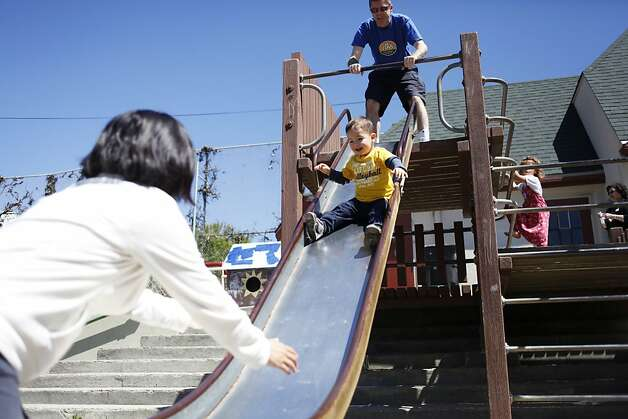 The city breaks ground on Cabrillo Playground in San Francisco, Calif. on Saturday, June 9, 2012. Anabelle Lee and Paul Brennan are playing with their son Xander, 2. The family is going to move to this neighborhood and wanted to check out the playground. Photo: Sonja Och, The Chronicle