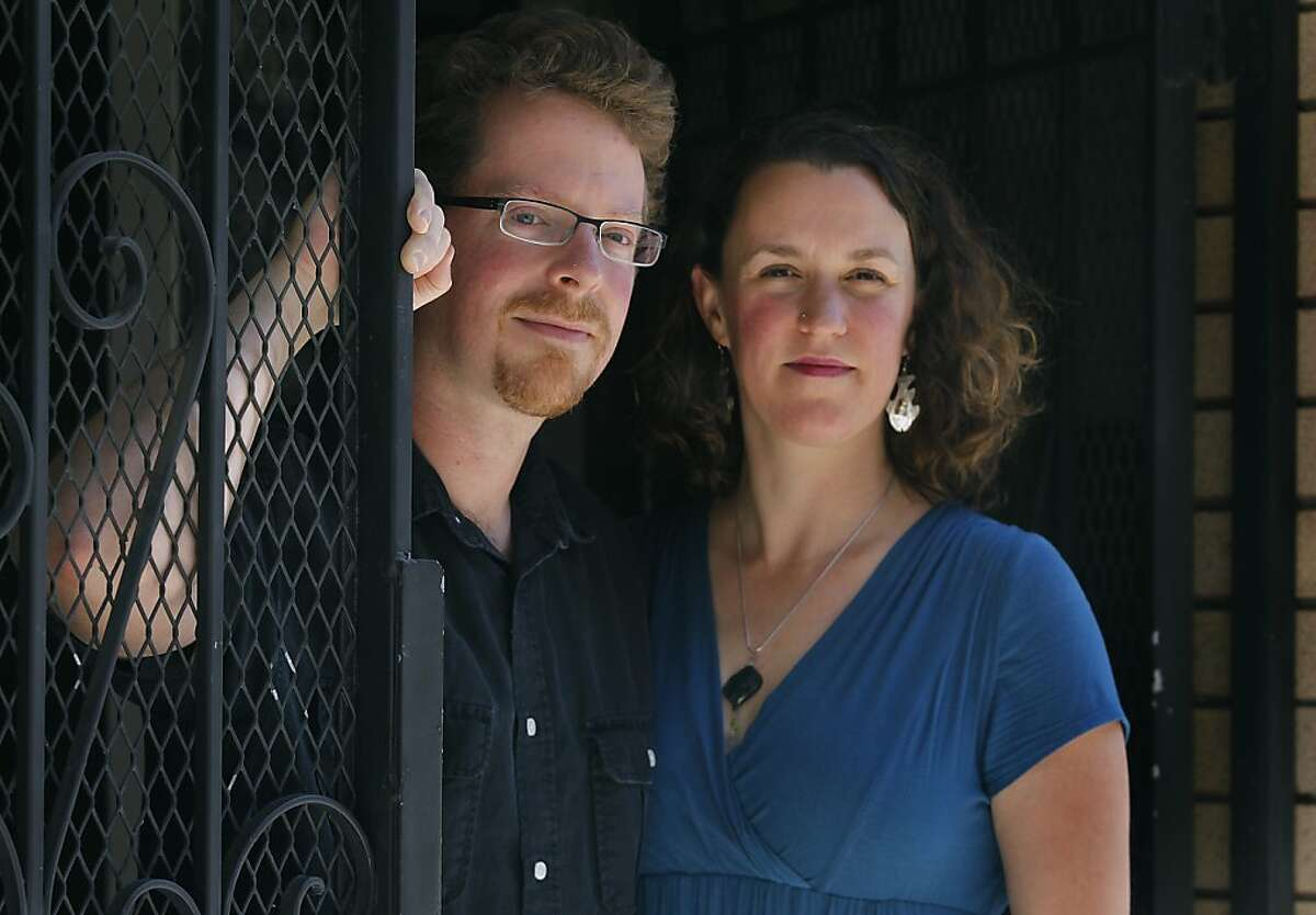 Barnaby Thieme and Rebecca Reagan stand at the front entrance to their apartment building in San Francisco, Calif. on Friday, June 1, 2012. Thieme and Reagan discovered that the apartment above theirs had a become an Airbnb rental property after several unfamiliar people tried to walk into their unit.