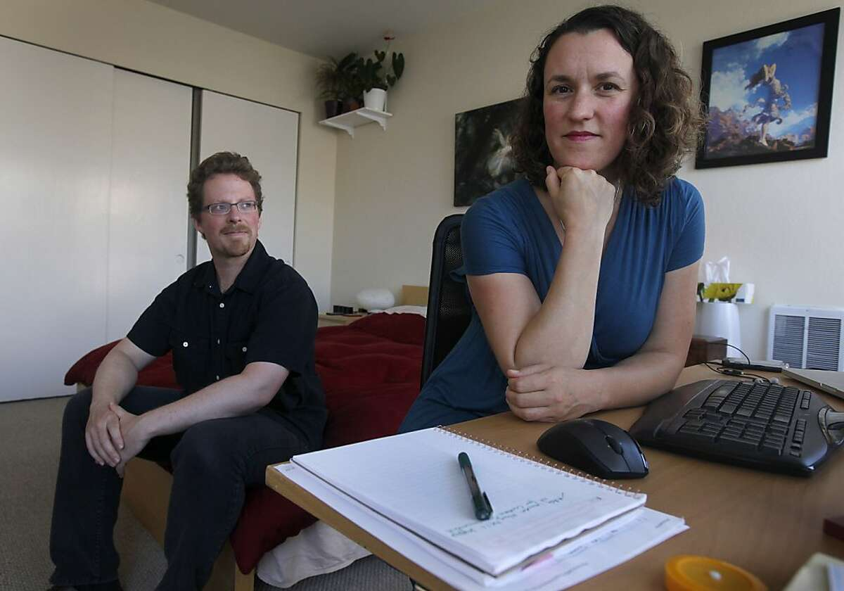 Barnaby Thieme and Rebecca Reagan relax at their home in San Francisco, Calif. on Friday, June 1, 2012. Thieme and Reagan discovered that the apartment above theirs had a become an Airbnb rental property after several unfamiliar people tried to walk into their unit.