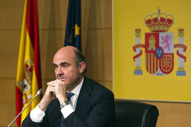 Luis de Guindos, Spain's economy minister, pauses as he speaks on the Spanish banking crisis during a news conference in Madrid, Spain, on Saturday, June 9, 2012. Spain asked euro region governments for a bailout worth as much as 100 billion euros ($125 billion) to rescue its banking system as the country became the biggest euro economy so far to seek international aid. Photographer: Angel Navarrete/Bloomberg *** Local Caption *** Luis de Guindos Photo: Angel Navarrete, Bloomberg