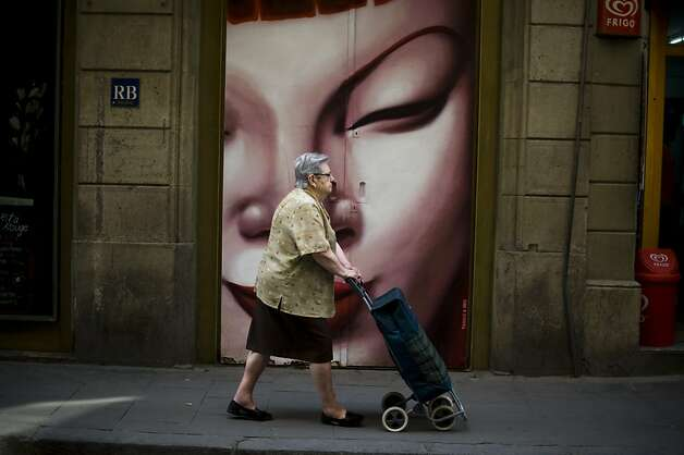 BARCELONA, SPAIN - JUNE 09:  A woman pushes a shopping trolley near a food market on June 9, 2012 in Barcelona, Spain. Spain will request European financial support for its distressed banks, on June 9 after emergency talks with eurozone ministers.  (Photo by David Ramos/Getty Images) Photo: David Ramos, Getty Images