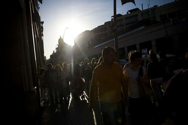 BARCELONA, SPAIN - JUNE 09:  People walk in the shopping area on June 9, 2012 in Barcelona, Spain. Spain will request European financial support for its distressed banks, on June 9 after emergency talks with eurozone ministers.  (Photo by David Ramos/Getty Images) Photo: David Ramos, Getty Images