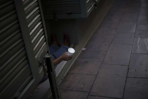 A man holds a cup as he begs in a street in Barcelona, Spain, Saturday June 9 2012. Spain will ask for a bank bailout from the eurozone, becoming the fourth and largest country to seek help since the single currency bloc's debt crisis erupted. (AP Photo/Emilio Morenatti) Photo: Emilio Morenatti, Associated Press