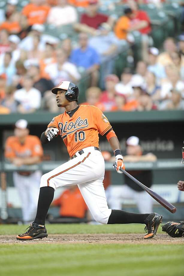 BALTIMORE, MD - JUNE 9:  Adam Jones #10 of the Baltimore Orioles hits a two run walk off home run in the twelfth during a interleague baseball game against the Philadelphia Phillies on June 9, 2012 at Oriole Park at Camden Yards in Baltimore, Maryland.  The Orioles won 6-4 in the twelfth inning.  (Photo by Mitchell Layton/Getty Images) Photo: Mitchell Layton, Getty Images