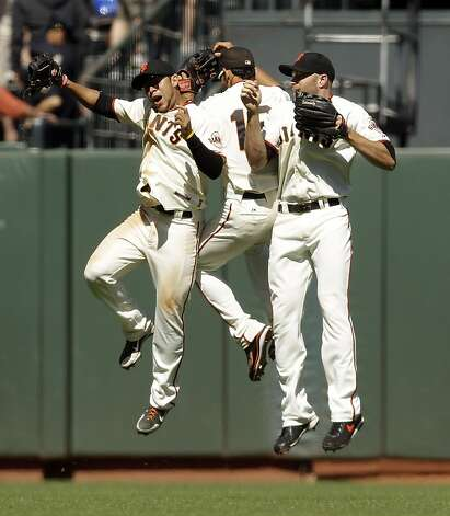San Francisco Giants, from left, Gregor Blanco, Angel Pagan and Nate Schierholtz celebrate a 5-2 win over the Texas Rangers in a baseball game in San Francisco, Saturday, June 9, 2012. (AP Photo/Marcio Jose Sanchez) Photo: Marcio Jose Sanchez, Associated Press