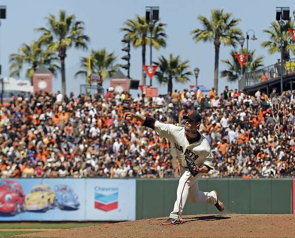 San Francisco Giants starting pitcher Ryan Vogelsong throws to the Texas Rangers during the eighth inning of a baseball game in San Francisco, Saturday, June 9, 2012. The Giants won 5-2. (AP Photo/Marcio Jose Sanchez) Photo: Marcio Jose Sanchez, Associated Press