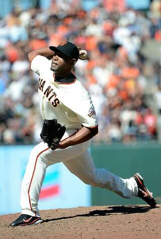 SAN FRANCISCO, CA - JUNE 09:  Santiago Casilla #46 of the San Francisco Giants pitches in the ninth inning against the Texas Rangers at AT&T Park on June 9, 2012 in San Francisco, California. The Giants won the game 5-2. (Photo by Thearon W. Henderson/Getty Images) Photo: Thearon W. Henderson, Getty Images