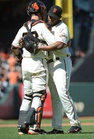 SAN FRANCISCO, CA - JUNE 09:  Santiago Casilla #46 and Buster Posey #28 of the San Francisco Giants celebrate defeating the Texas Rangers 5 to 2 at AT&T Park on June 9, 2012 in San Francisco, California. The Giants won the game 5-2.  (Photo by Thearon W. Henderson/Getty Images) Photo: Thearon W. Henderson, Getty Images