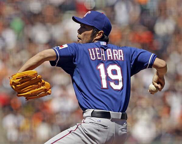 Texas Rangers relief pitcher Koji Uehara throws to the San Francisco Giants during the seventh inning of a baseball game in San Francisco, Saturday, June 9, 2012. The Giants won 5-2. (AP Photo/Marcio Jose Sanchez) Photo: Marcio Jose Sanchez, Associated Press