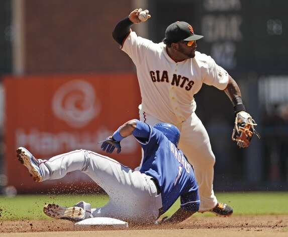 San Francisco Giants third baseman Pablo Sandoval, top, attempts a double play over Texas Rangers' Elvis Andrus on a ground ball by Josh Hamilton during the first inning of a baseball game in San Francisco, Saturday, June 9, 2012. Hamilton was safe at first. (AP Photo/Marcio Jose Sanchez) Photo: Marcio Jose Sanchez, Associated Press
