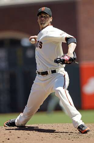 San Francisco Giants starting pitcher Ryan Vogelsong throws to the Texas Rangers during the third inning of a baseball game in San Francisco, Saturday, June 9, 2012. (AP Photo/Marcio Jose Sanchez) Photo: Marcio Jose Sanchez, Associated Press