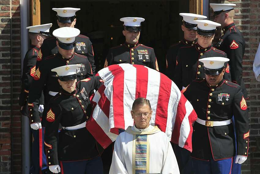 Marine pallbearers carry the casket of Pfc. John Albert Donovan after a funeral service at the Old St. Patrick Catholic Church in Northfield Township, Mich., Friday, June 8, 2012. Nearly seven decades after he went missing following a World War II bomber crash, Donovan was laid to rest in a cemetery across the street from the church. His remains were identified this year. (AP Photo/Carlos Osorio)