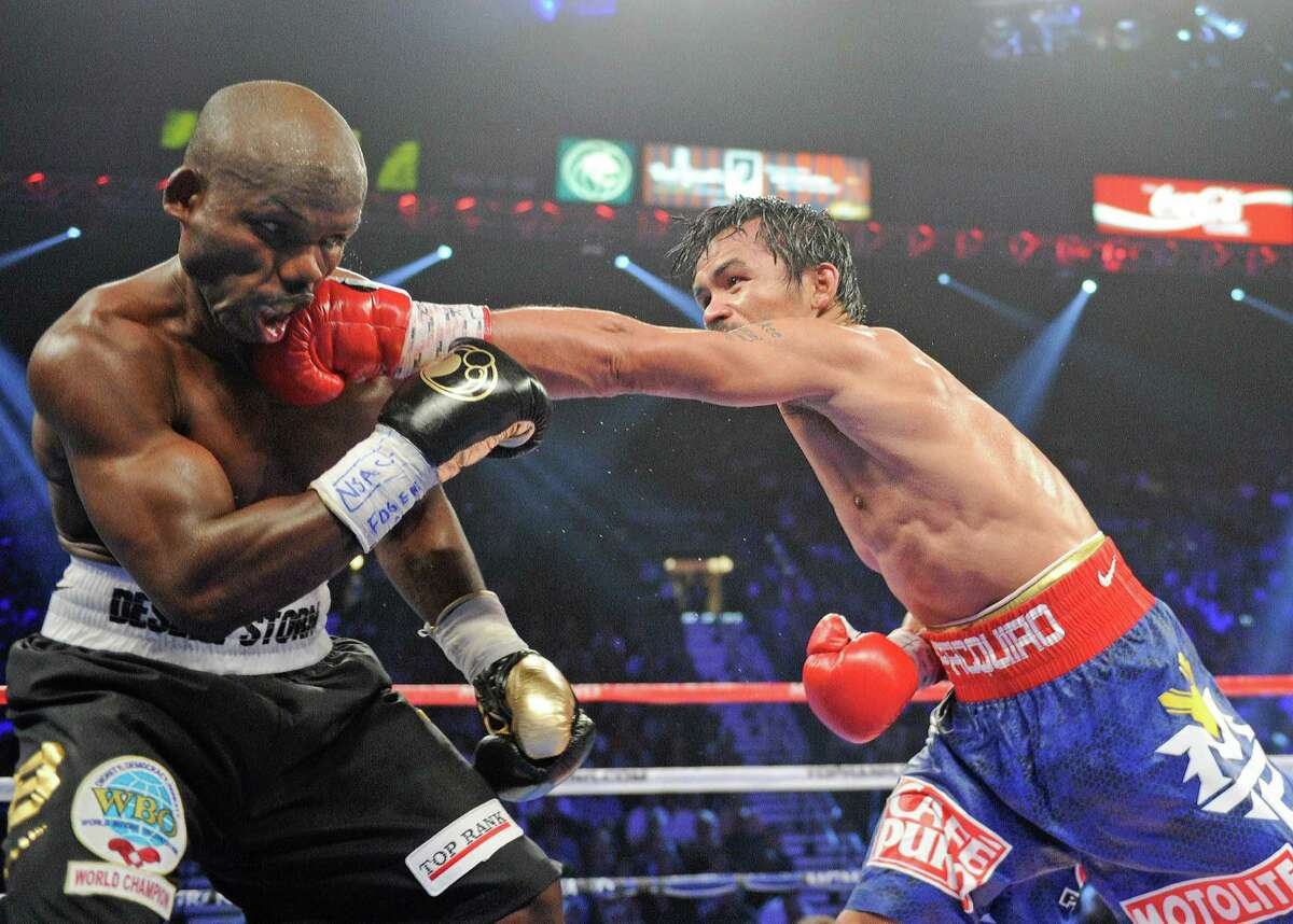 Manny Pacquiao, from the Philippines, right, lands a left to the head of Timothy Bradley, from Palm Springs, Calif., in their WBO world welterweight title fight Saturday, June 9, 2012, in Las Vegas.