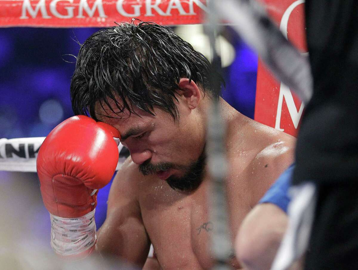 Manny Pacquiao, from the Philippines, sits in his corner following the tenth round of his WBO welterweight title fight against Timothy Bradley, from Palm Springs, Calif., Saturday, June 9, 2012, in Las Vegas. Bradley won the bout by split decision.