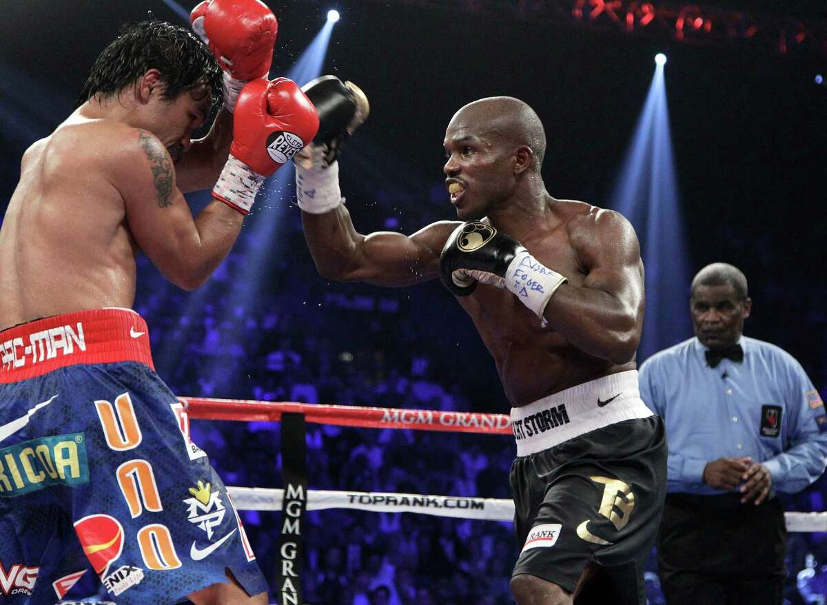 Timothy Bradley, from Palm Springs, Calif., goes on the offense against Manny Pacquiao, from the Philippines, in their WBO world welterweight title fight Saturday, June 9, 2012, in Las Vegas. Bradley won the fight by split decision.