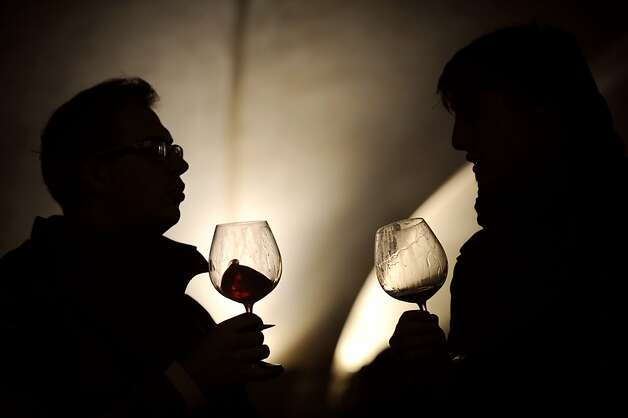 People taste wine in the 'Nouvelle cuverie' (new wine tank room) prior to the 150th edition of the Hospices de Beaune charity auction wine sale, on November 21, 2010 in Beaune, central France. The auction, a major Burgundian event, forms the greatest charity wine auction in the world and gathers wine professionals for more than 80 years. AFP PHOTO / JEFF PACHOUD (Photo credit should read JEFF PACHOUD/AFP/Getty Images) Photo: Jeff Pachoud, AFP/Getty Images