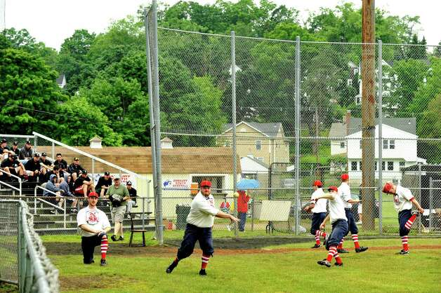 The Newtown Sandy Hooks play the Westfield Wheelmen in a vintage baseball game, with costumes and rules from 1886, in Danbury Saturday, June 9, 2012. Photo: Michael Duffy / The News-Times