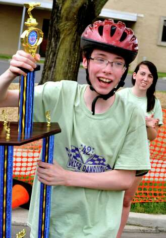 John Yeargin, 11, of Brookfield, celebrates his trophy awarded in the Super Kids Division at the Danbury Soap Box Derby Sunday, June 10, 2012. Photo: Michael Duffy