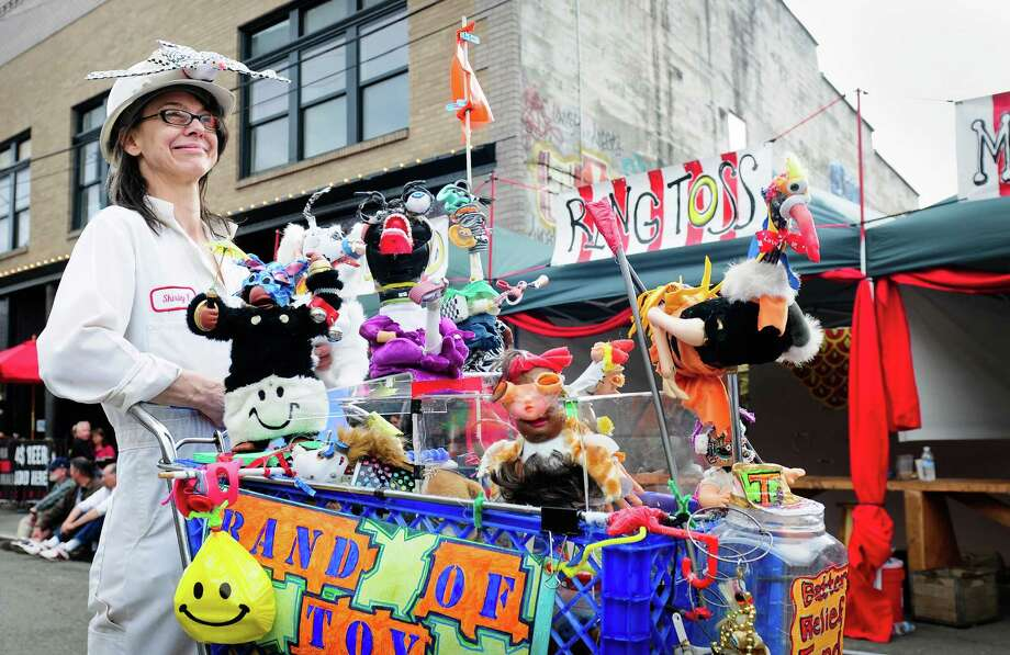 """Grace Dager wheels around her """"Band of Toys"""" during the Georgetown Carnival in Seattle on Saturday, June 9, 2012. The annual carnival featured musical performances, power tool races, carnival games and interactive art. Photo: LINDSEY WASSON / SEATTLEPI.COM"""