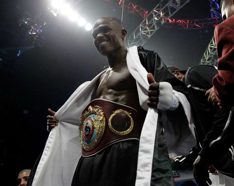 Timothy Bradley shows off his WBO welterweight title belt after his split decision over Manny Pacquiao late Saturday. Photo: Julie Jacobson, Associated Press