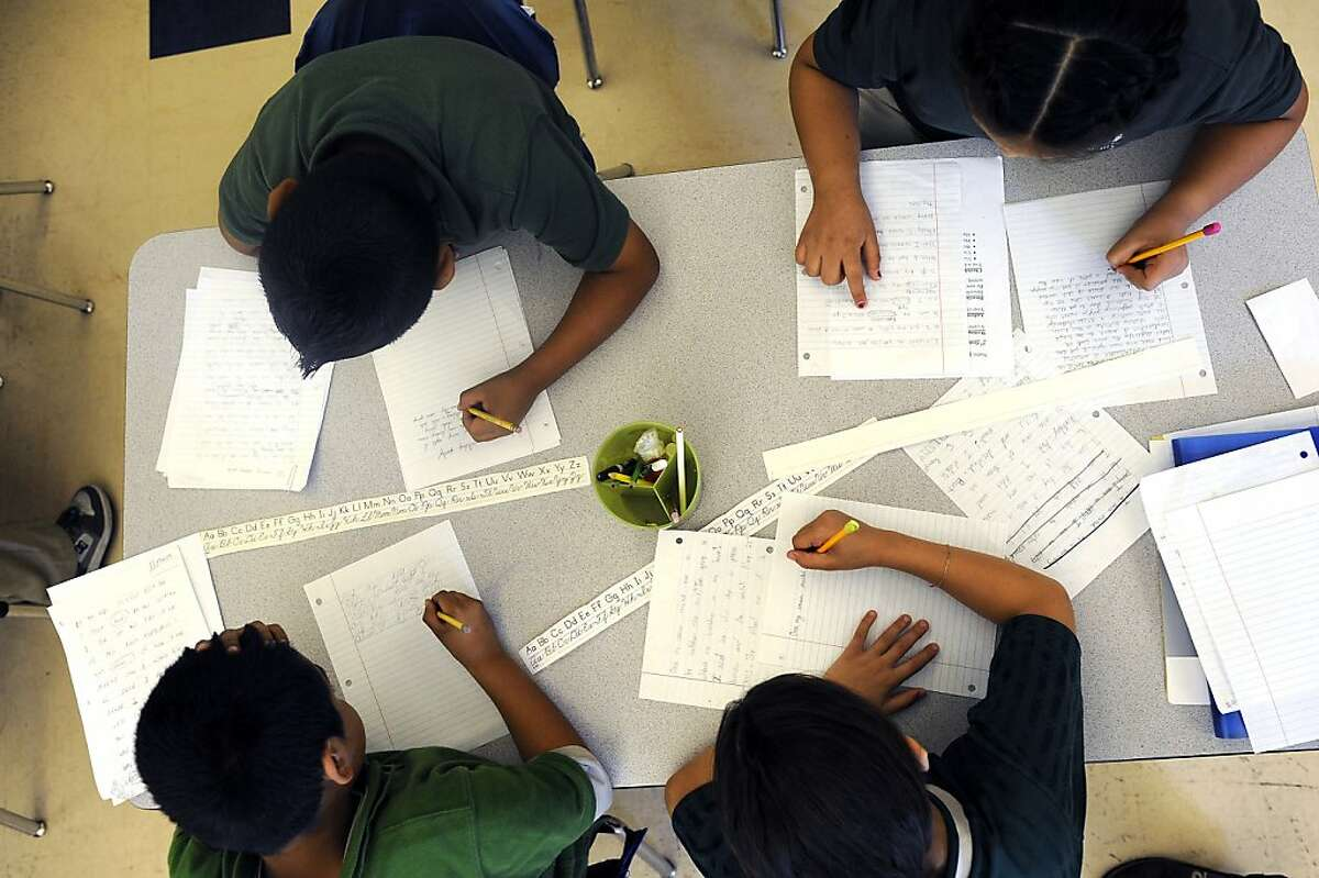 Students are seen working on their cursive writing in Oceanhawk's 3rd grade class at Encompass Academy in East Oakland, CA June 6th, 2012