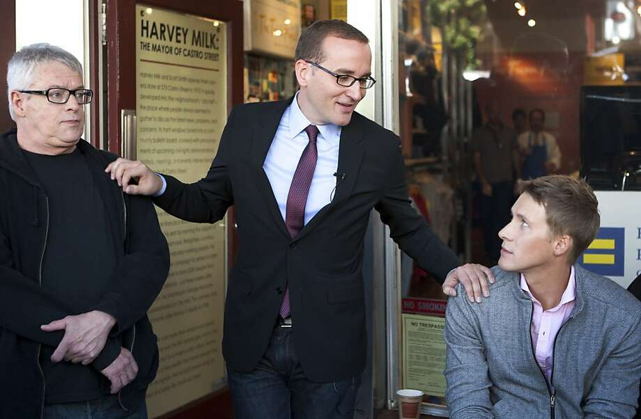 Chad Griffin (center) rests his hands on the shoulders of Cleve Jones (L) and Dustin Lance Black (R) on Sunday as he gives a speech outside of the HRC Action Center & Store in the Castro district. Chad Griffin, the new president of the Human Rights Campaign, visited the HRC Action Center & Store and the Harvey Milk Academy to meet with the LBGT community on Sunday. Photo: Kevin Johnson, The Chronicle
