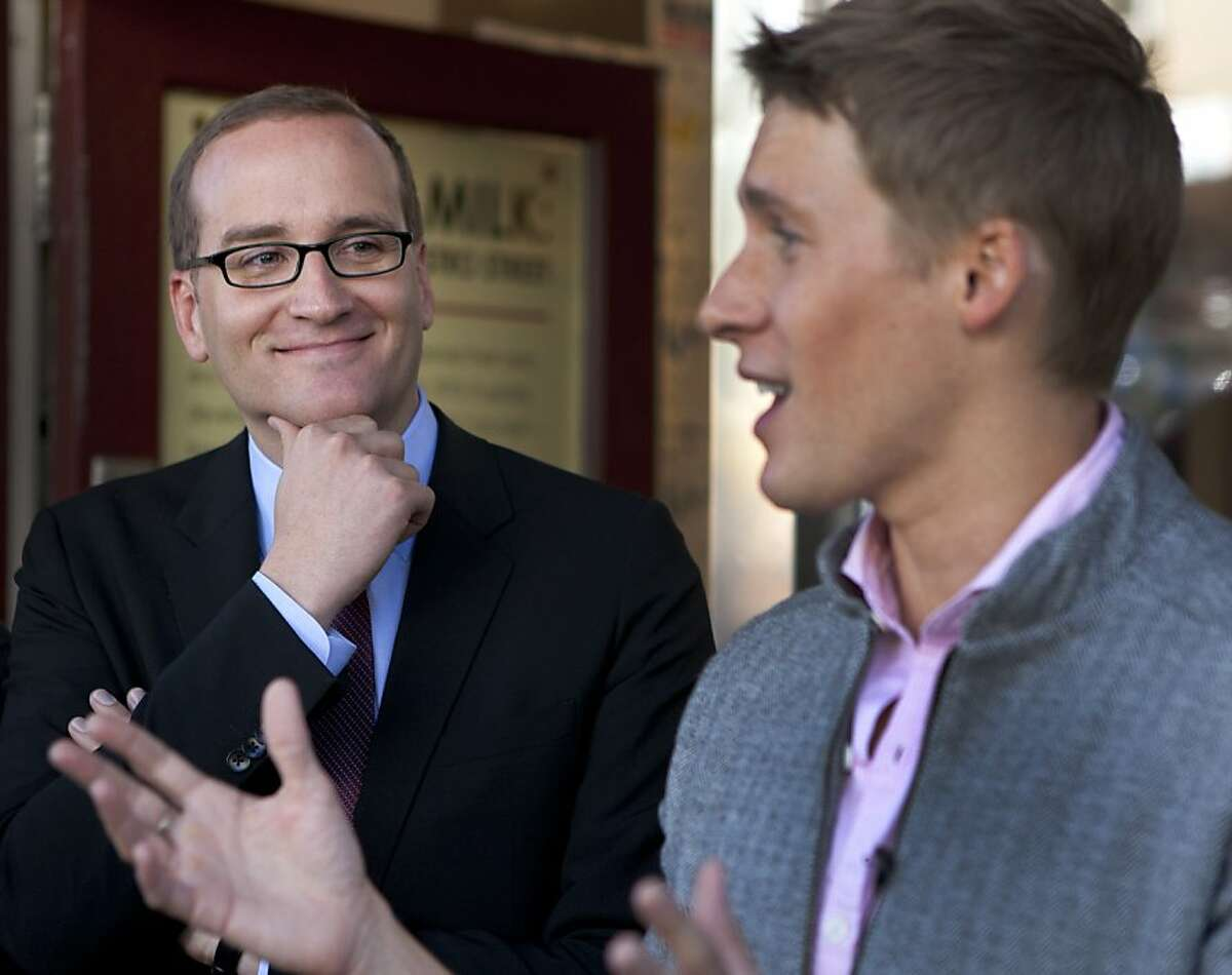 Chad Griffin (L), smiles as he listens to a speech by screenwriter Dustin Lance Black on Sunday outside of the HRC Action Center & Store where they met with members of the LGBT community. Chad Griffin, the new president of the Human Rights Campaign, visited the HRC Action Center & Store and the Harvey Milk Academy to meet with the LBGT community on Sunday.