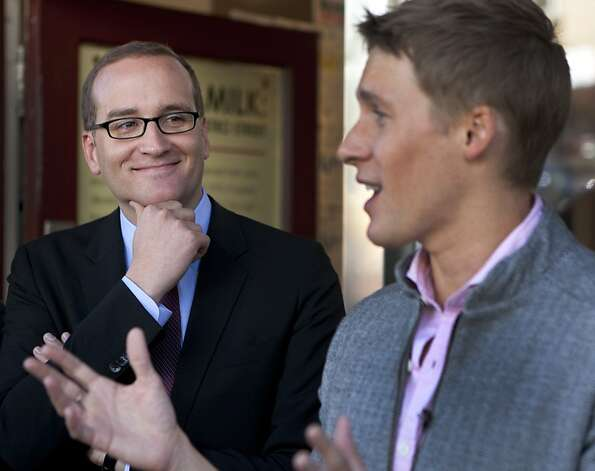 Chad Griffin (L), smiles as he listens to a speech by screenwriter Dustin Lance Black on Sunday outside of the HRC Action Center & Store where they met with members of the LGBT community. Chad Griffin, the new president of the Human Rights Campaign, visited the HRC Action Center & Store and the Harvey Milk Academy to meet with the LBGT community on Sunday. Photo: Kevin Johnson, The Chronicle