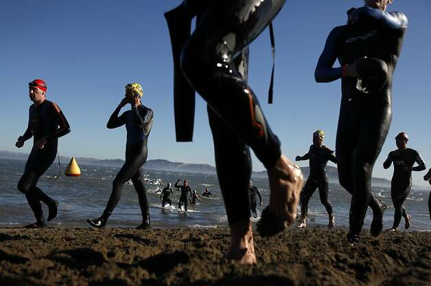 Athletes emerge from the water after swimming from Alcatraz during the Escape from Alcatraz Triathlon in San Francisco, Calif., Sunday, June 10, 2012. Photo: Sarah Rice, Special To The Chronicle