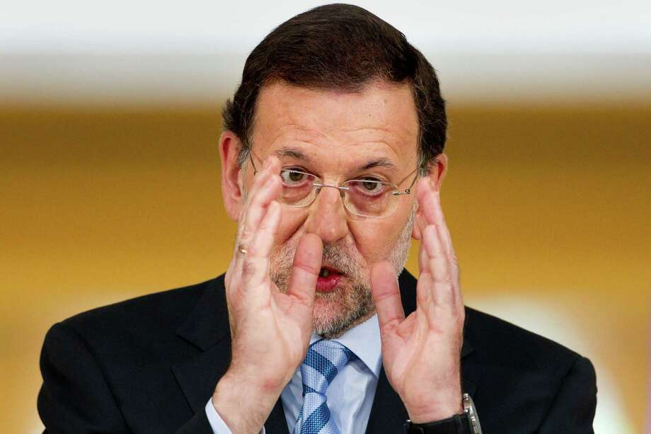 Spain's Prime Minister Mariano Rajoy speaks during a press conference at the Moncloa Palace, in Madrid, Sunday, June 10, 2012. Spain became the fourth and largest country to ask Europe to rescue its failing banks, a bailout of up to 100 billion euros ($125 billion) that leaders hoped would stabilize a financial crisis that threatens to break apart the 17-country eurozone. Photo: Daniel Ochoa De Olza, Associated Press