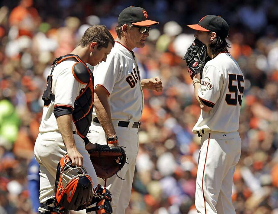 San Francisco Giants starting pitcher Tim Lincecum, right, gets a visit to the mound from pitching coach Dave Righetti, center, and catcher Buster Posey during the sixth inning of a baseball game against the Texas Rangers in San Francisco, Sunday, June 10, 2012. (AP Photo/Marcio Jose Sanchez) Photo: Marcio Jose Sanchez, Associated Press