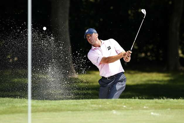 Matt Kuchar hits out of a bunker onto the seventh green during the second round of the PGA Colonial golf tournament Friday, May 25, 2012, in Fort Worth, Texas. (AP Photo/Tony Gutierrez) Photo: Tony Gutierrez, Associated Press