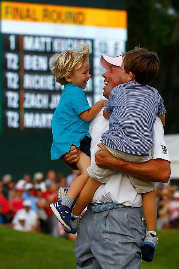 PONTE VEDRA BEACH, FL - MAY 13:  Matt Kuchar of the United States hugs his children Cameron amd Carson after holing the winning putt on the par 4, 18th green during the final round of THE PLAYERS Championship held at THE PLAYERS Stadium course at TPC Sawgrass on May 13, 2012 in Ponte Vedra Beach, Florida.  (Photo by Mike Ehrmann/Getty Images) Photo: Mike Ehrmann, Getty Images