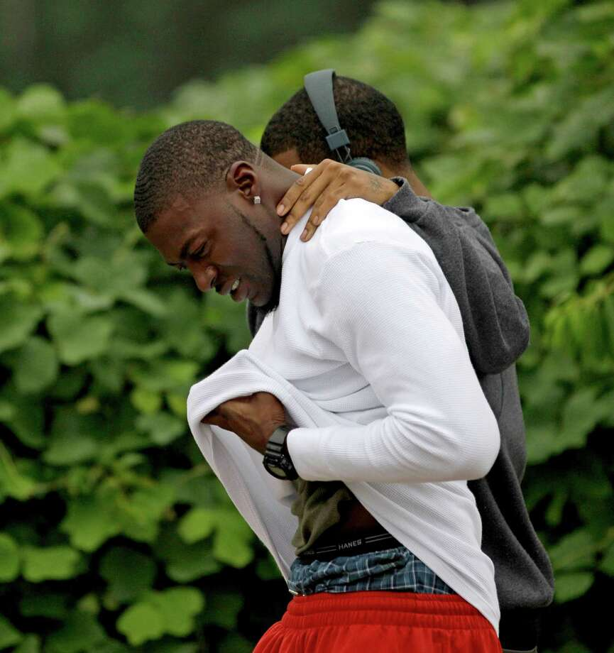 Mourners leave the scene Sunday of an overnight shooting in which three were killed, including two former Auburn University football players. Photo: David Goldman / AP