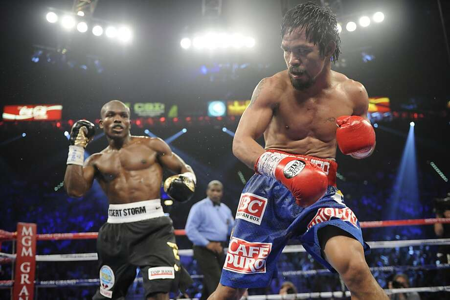 Manny Pacquiao, right, and Timothy Bradley during their WBO world welterweight title fight Saturday, June 9, 2012, in Las Vegas. (AP Photo/Chris Carlson) Photo: Chris Carlson, Associated Press