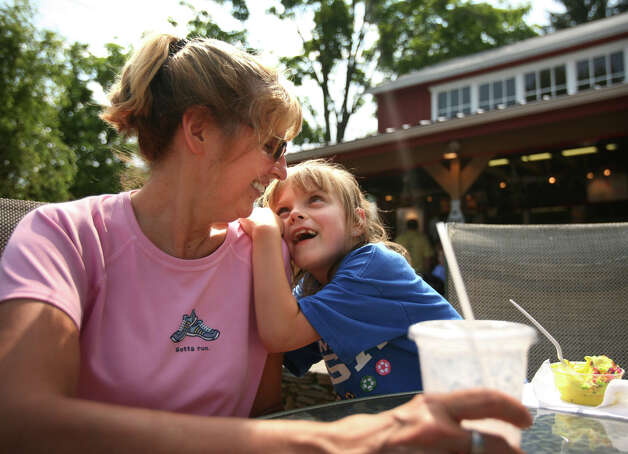 Donna O'Reilly shares a special moment over some ice cream with her granddaughter, Faith Sanfratello, 7, both of Stratford, at Well's Hollow Farm Creamery in the Huntington section of Shelton on Sunday, June 10, 2012. Photo: Brian A. Pounds / Connecticut Post