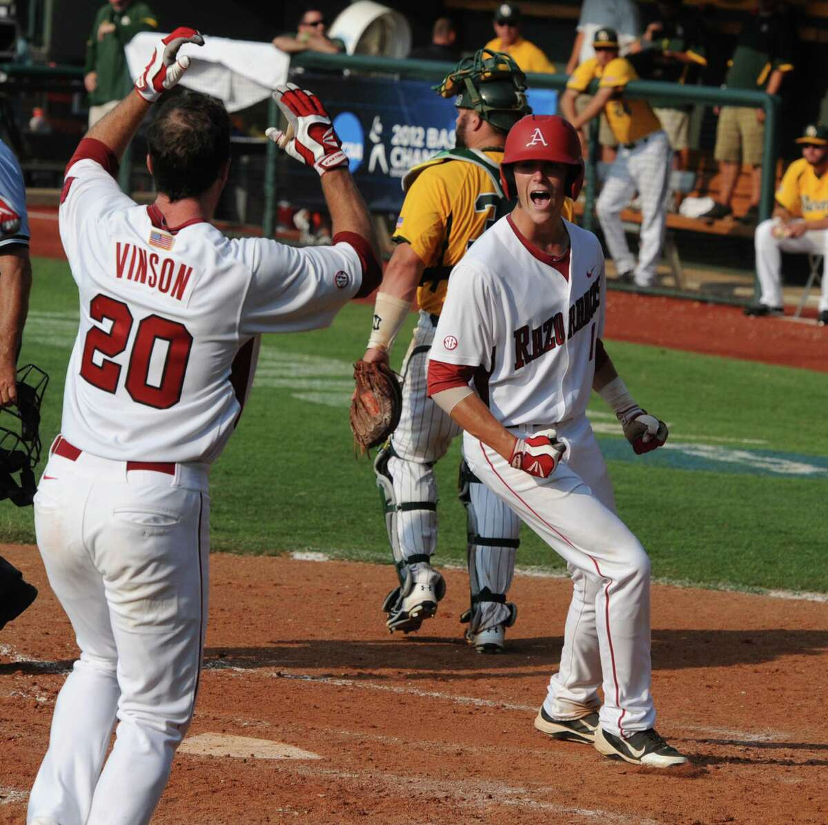 Arkansas' Brian Anderson, right, celebrates with teammate Matt Vinson (20) after scoring the game-winning run on a hit batter in the bottom of the ninth inning of an NCAA college baseball tournament super regional game against Baylor, Sunday, June 10, 2012, in Waco.
