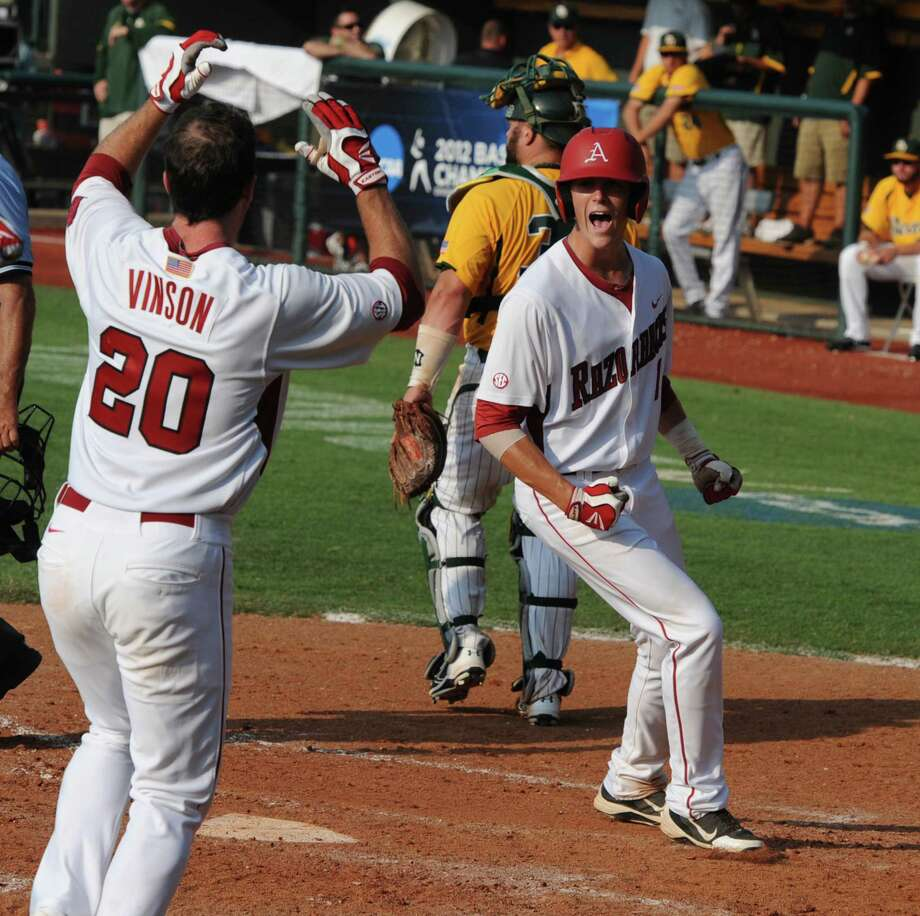 Arkansas' Brian Anderson, right, celebrates with teammate Matt Vinson (20) after scoring the game-winning run on a hit batter in the bottom of the ninth inning of an NCAA college baseball tournament super regional game against Baylor, Sunday, June 10, 2012, in Waco. Photo: AP Photo/Waco Tribune Herald,  Rod Aydelotte